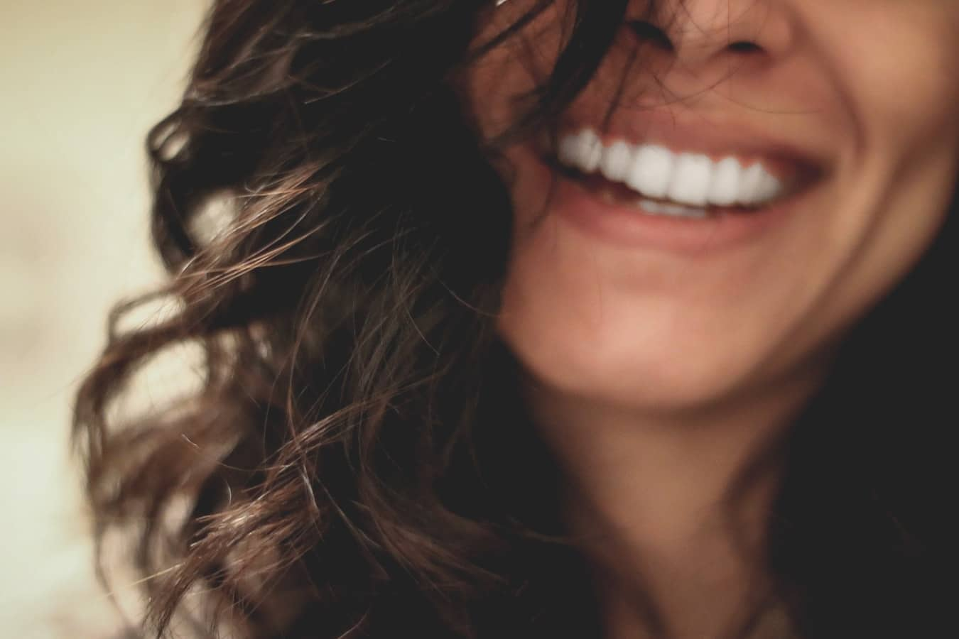 Woman with white teeth smiling